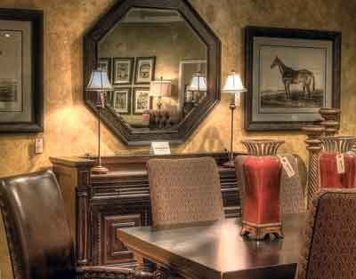 A Tommy Bahama Kingstown dining room setting by Lexington Home Brands is featured in the 2,500-square-foot Lexington gallery at Larrabee's Furniture & Design in Denver.