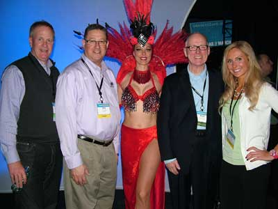Robbie VanHoose, left, Big Sandy Superstore, Franklin Furnace, Ohio; Andy Bernstein, FurnitureDealer.net; a Las Vegas showgirl; Martin Roberts, Martin Roberts Design; and Lidia Chesnokova, FurnitureDealer.net.