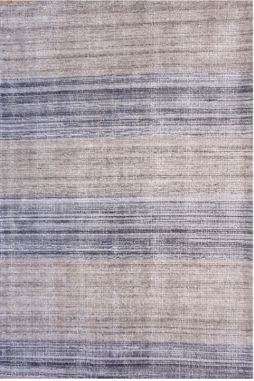 This model FLS4963 rug is hand-woven of wool in India. Retail for a 5 by 7-foot-3 is $538.