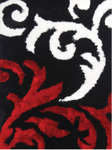 Rug introductions include this entry from the Fassion collection in hand-tufted polyester.
