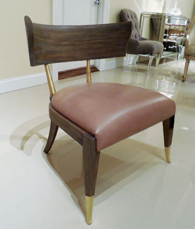 Caracole's All Greek to Me Klismos chair has brass accents and a seagull finish on birch. Retail is $945.