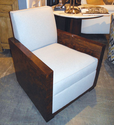 The Perry chair by Lillian August is inspired by furniture archives. The wood is walnut. It retails at $3,750.