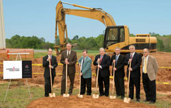 At the groundbreaking for the Hickory Springs Mfg. plant expansion are company executives Cam McLaughlin, left, Buster Mann, Bobby Bush, Dave Colburn, Dwayne Welch, Lee Lunsford and Conway Wilson.
