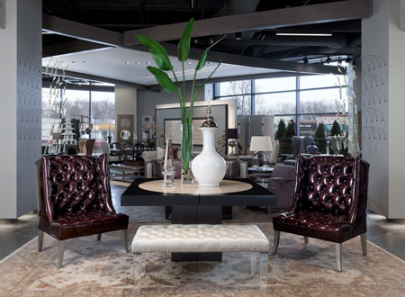 The entryway to the new Scott Shuptrine Interiors in Royal Oak, Mich., features a modern-leaning vignette and the retailer's trademark mix of upscale sources, including a Stone International dining table, Nathan Anthony Seville Chair, Massoud bench with Lucite legs and Momeni Chobo Pakistani rug.