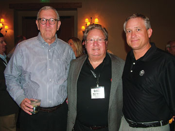 Bill Koslo, left, and Ron Wanek, Ashley Furniture Inds.; Dwayne Welch, HSM.