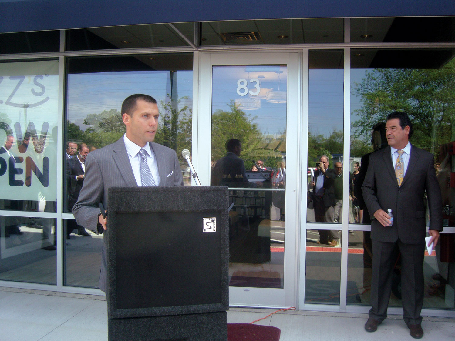 Ben Thorud of Ashley speaks at the ribbon-cutting ceremony for the new store.