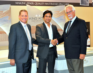 Archit Gupta, center, managing director of Real Innerspring Technologies of New Delhi, meets at the summer Las Vegas Market with King Koil executives J.P. Ledoux, left, and Owen Shoemaker.