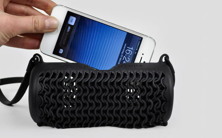 Freshfiber's 3D printed Pineapple Shoulder Bag and Case for iPhone 5 is made from printed nylon, leather, and magnets.