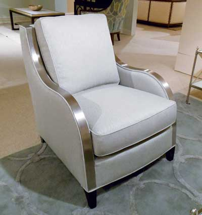 The Celia by Michael Thomas Furniture is a 100% domestic chair, including the metal trim, which is made in North Carolina. It's a perfect fusion of modern, metal, glamour and elegance.