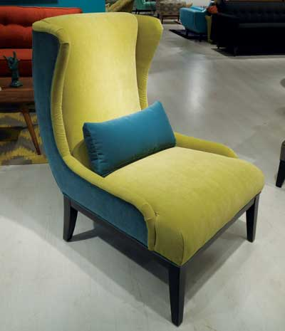 Younger Furniture's Cash chair features two key color influences — deep peacock blue and chartreuse — in velvet. The curvy frame profile adds movement and whimsy.