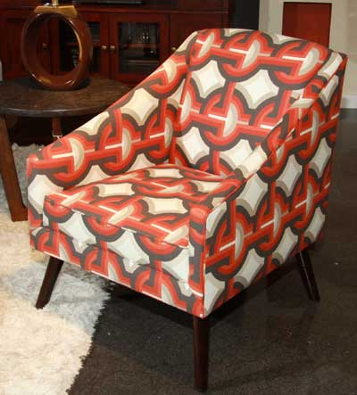 Bassett's Monroe chair has a mid-century style and geometric orange and gray fabric.