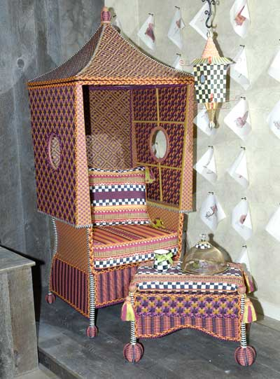 MacKenzie-Childs' combined a distinctive mix of patterns with an unusual frame in the Sunset Beach Hut accent chair.