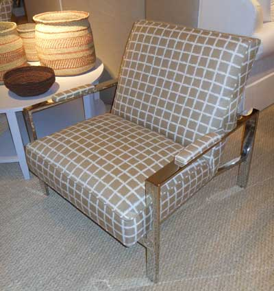 Classic menswear goes mod and durable via Sunbrella fabric in Joe Ruggiero's accent chair for Michael Thomas/Miles Talbott.