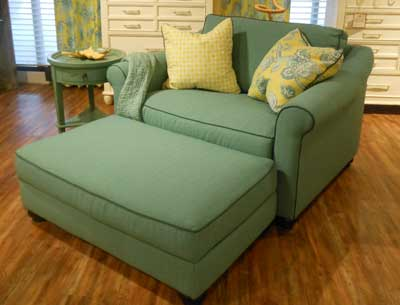 The Carolina Preserves collection by William Mangum for Klaussner Home Furnishings features a chair and a half shown in contrasting shades of blue.