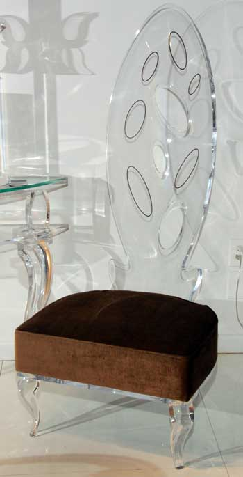 Philippe Starck's Ghost chair has become a classic for people who love the clean aesthetic of see-through furnishings. Shahrooz reinterpreted a dining chair in acrylic and added the comfort of a cushion, a combination that brought people into the showroom and enticed them to sit.