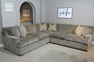 Sectionals like this model from Aria Designs are deeper than ever, offering cuddle/lounge space. www.ariadesigns.net