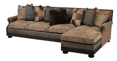 Massoud Furniture's sectional pairs leather with Line Truffle fabric to create a distinctive style combination. www.massoudfurniture.com
