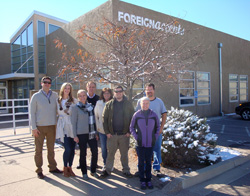 Members of the Foreign Accents Rugs team pose in front of their Albuquerque headquarters.