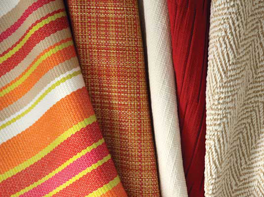 Bella-Dura showed vibrant warm hues with (from left) Dexter, Grasscloth, St. Tropez, Lewitt and Shelby.