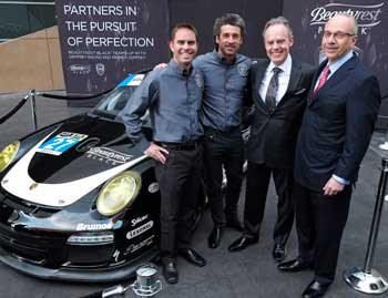 Dempsey Racing drivers Andrew Davis, left, and Patrick Dempsey meet with Simmons President Tony Smith and Simmons CEO Gary Fazio in the courtyard of the World Market Center.}