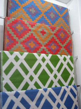 New Jersey-based company Fab Habitat showcased new patterns for its indoor/outdoor rugs, woven from straws made of recycled plastic. Shown here, top to bottom, are Saman in blue and orange, Saman in orange and violet, Dublin in lime green and white and Dublin in Dazzling Blue and white.