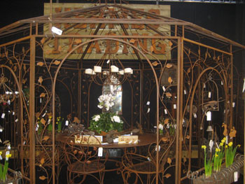 Hermes Trading of Belgium produces a wide array of wrought iron garden décor, from seating and gazebos to candelabras and planters.