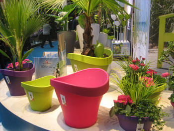 "Scheurich of Germany, whose tagline is ""Color your home, color your garden,"" showcased a variety of vibrant planters and garden accessories, such as the Wave collection of pots."