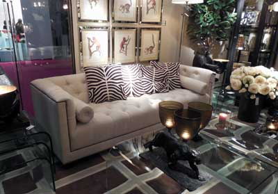 Eichholtz's Davidoff Chesterfield sofa is available in olive light leather and taupe, sand and black fabrics.