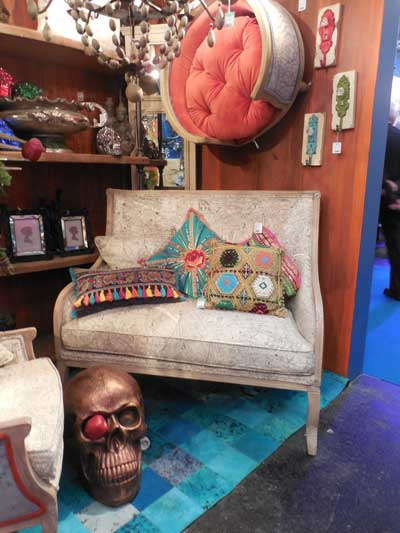 Kare Designs showcased a variety of vignettes at Ambiente, including this settee shown with accent upholstery and accessories.