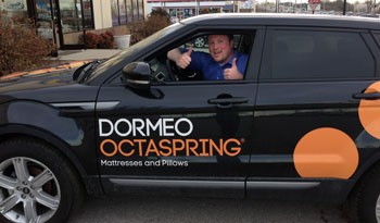 Walter Arnett at the wheel of his 2013 Range Rover, which he won in a contest sponsored by Dormeo N.A.
