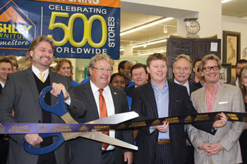 Officials of the Dufresne Spencer Group and Ashley gather for the grand opening of the 500th Ashley Furniture HomeStore in Longview, Texas.