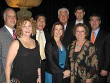 Dave Heard, left, and Donna Favia, both of Furniture Values International/Aspenhome;  Lawrence Yen, Woodworth Inds.; and Renee Loper, Bill Colegrove, Bryan Edwards, Jena Hall and Mike Watson, all of Furniture Values International/Aspenhome