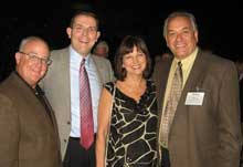 Ty Wimbs, left, Bassett; Bill Vanden Boomen, Buhler Furniture; Connie and David Beckmann, Emerald Home Furnishings.