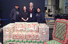 Gallery Furniture owner Jim McIngvale with the team that made his store's gingerbread furniture.
